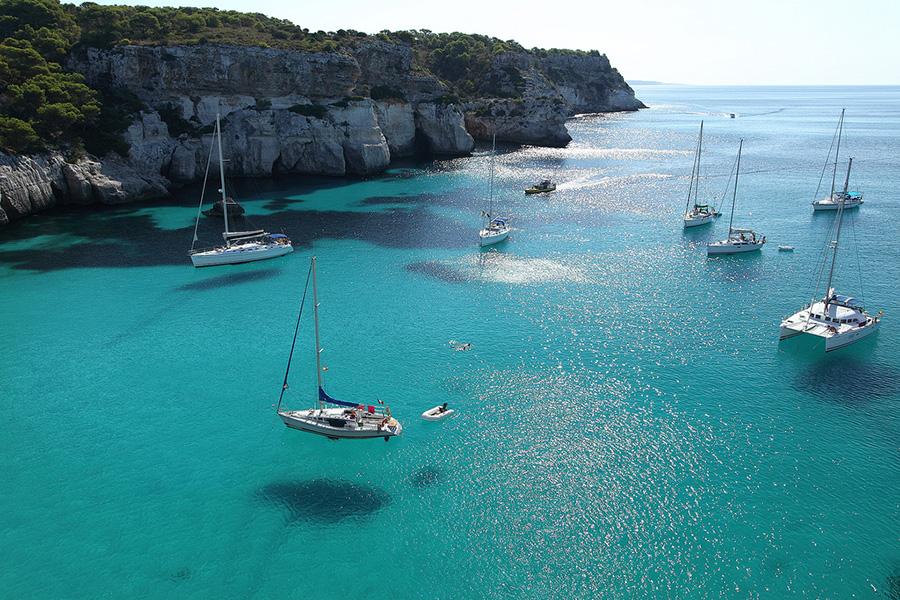 chartering a boat in Cala Macarella Beach Minorca, Spain