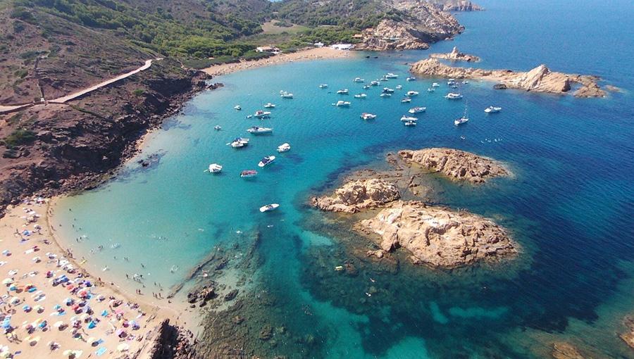 charter a boat in Cala Pregonda, Spain