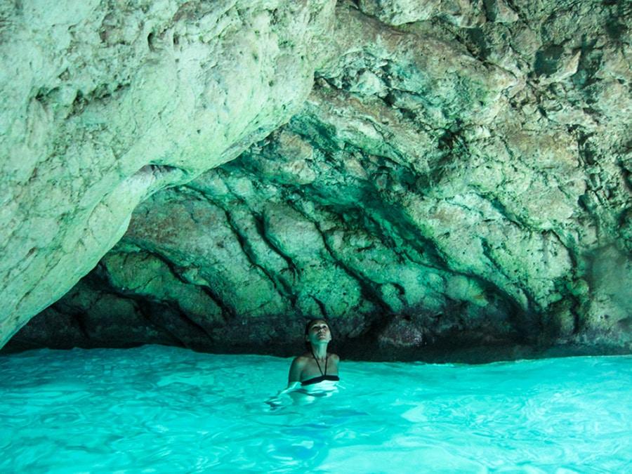 woman enjoying a swim in the Green Cave on Vis Island in Croatia