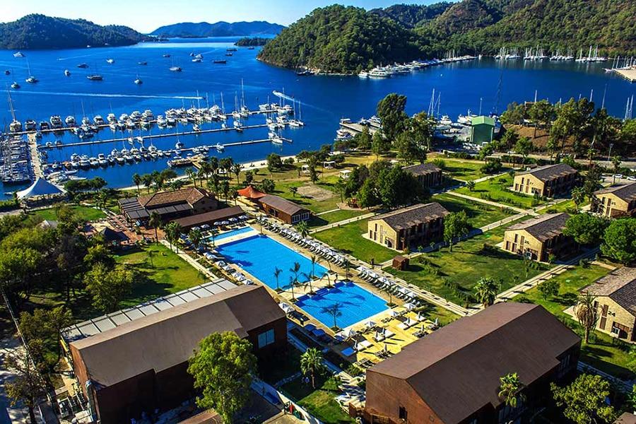 boats docked in a marina by a resort in Gocek Turkey
