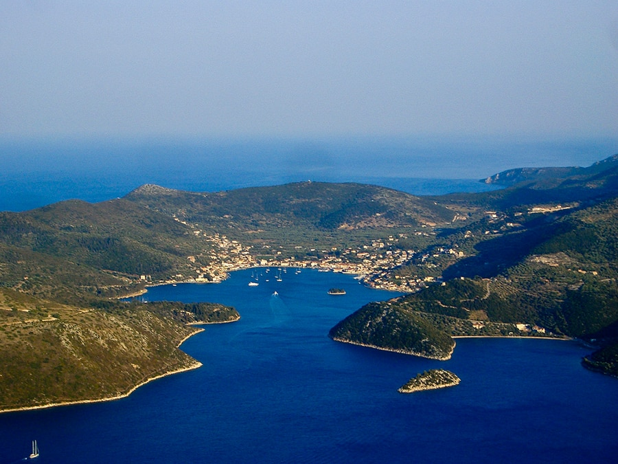 aerial view of boats setting sail for the lagoon of Ithaca in Greece