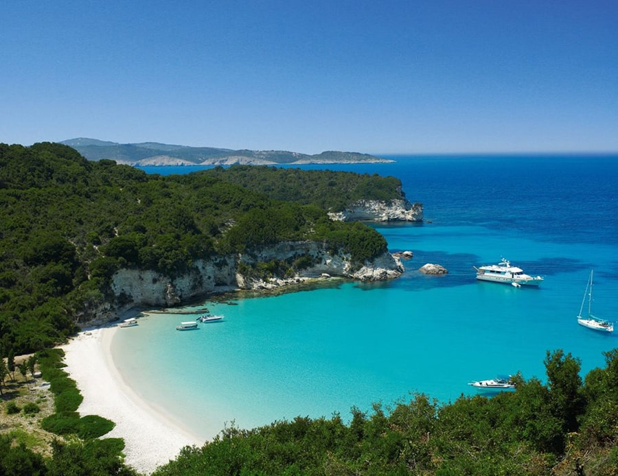 boats sailing for secluded unearthly beach in Paxoi