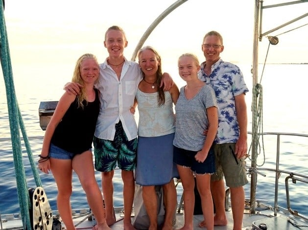 a family ona old boat deck posing for sailing totem