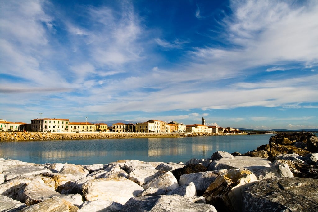 a sunny day in Pisa overlooking its coastal buildings