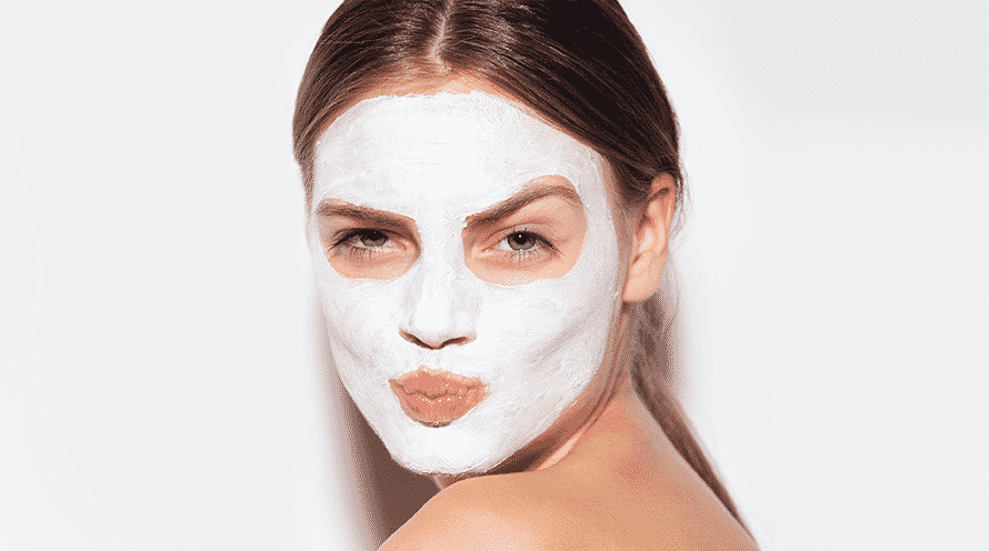 white skin mask for face care on a girl