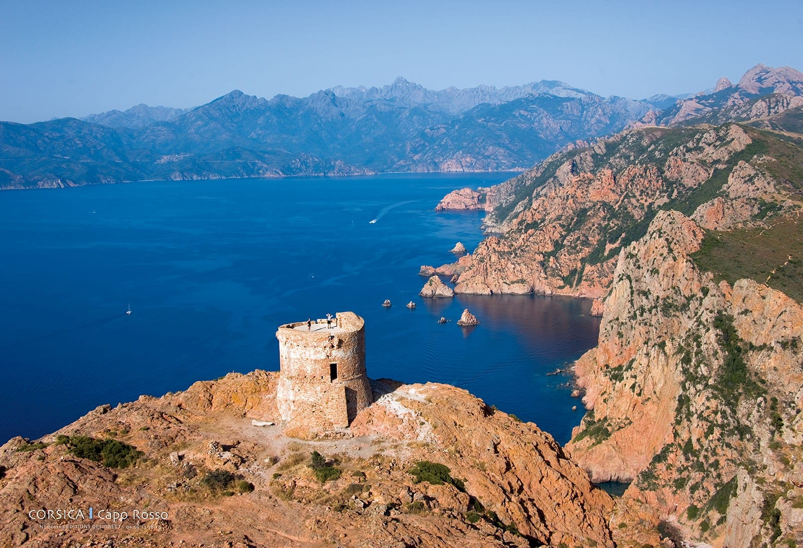 old tower on the coast of a rocky CALANQUES DE PIANA AND CAPO ROSSO