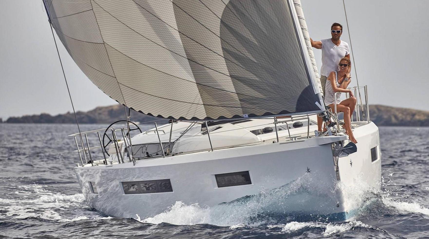 couple sailing Jeanneau Sun Odyssey 490 in Turkey