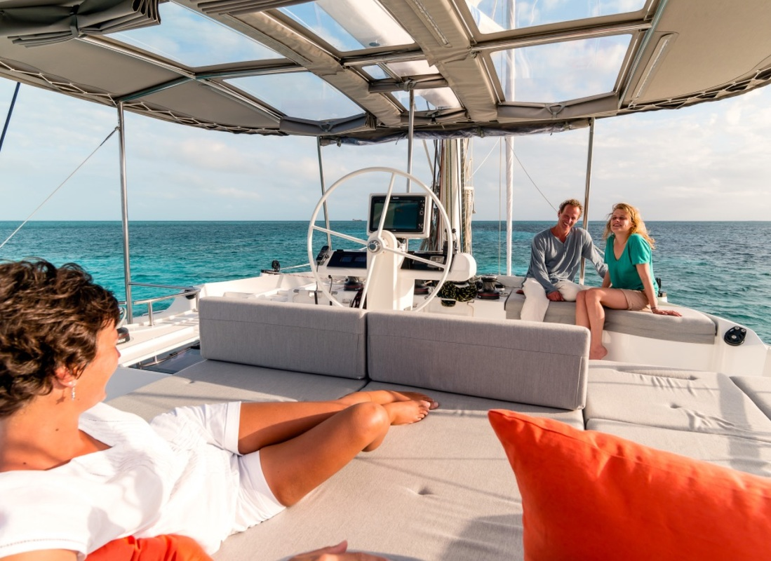 friends enjoy on the deck of a Lagoon 520