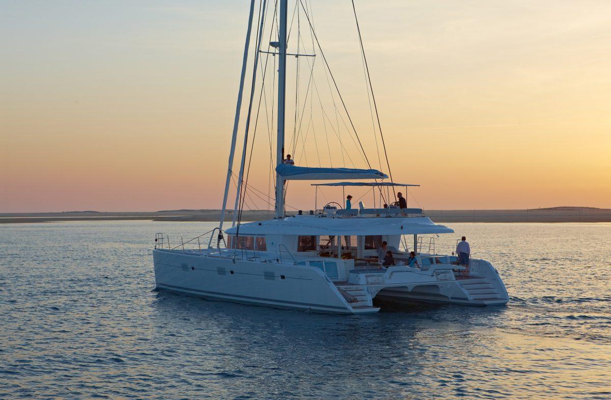 Lagoon 620 sailing sunset