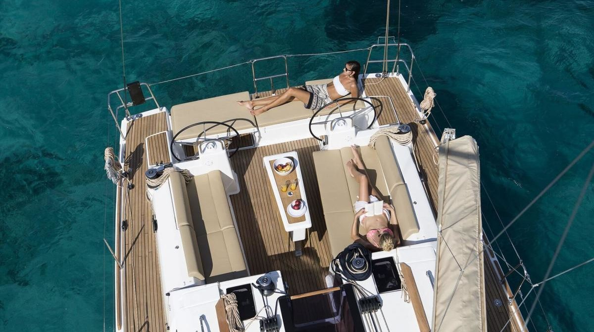 2 people relaxing on yacht deck and sunbathing