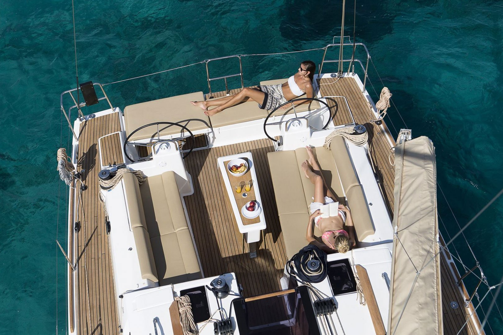 girls relaxing and sunbathing on a Dufour 460 Grande Large