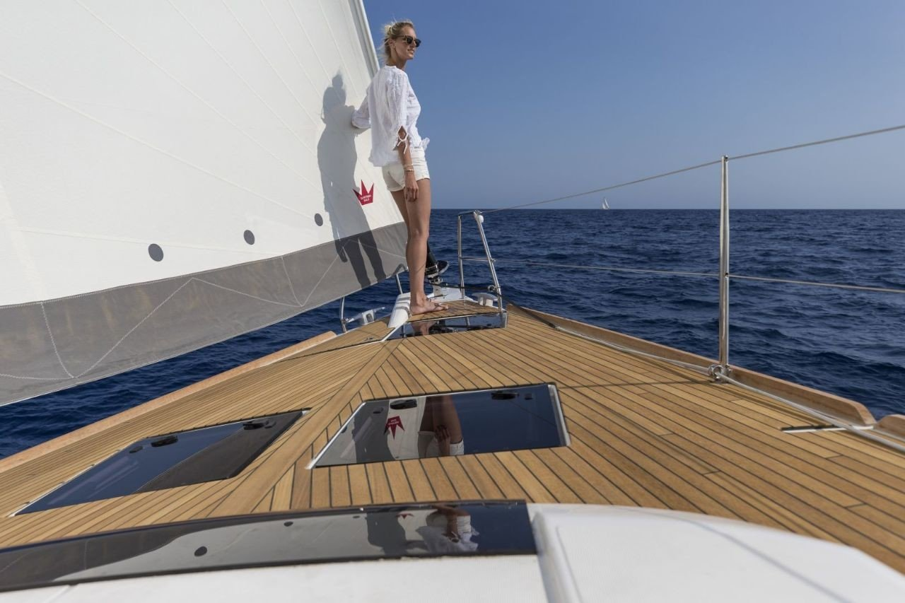 woman aborad the deck of Dufour 520 GL