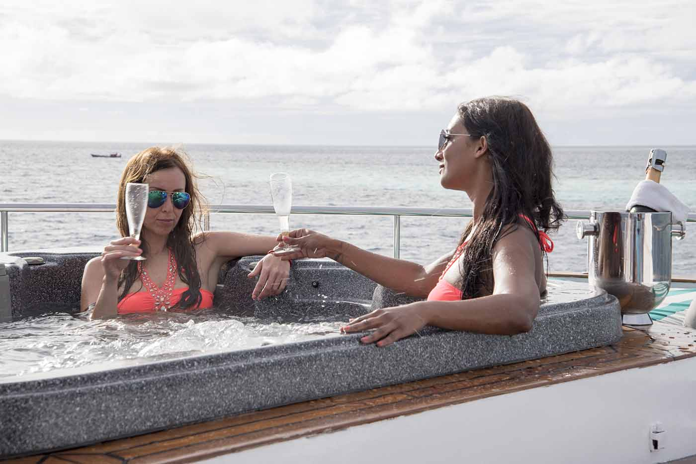 girls relaxing in a jacuzzi on the Honors Legacy yacht