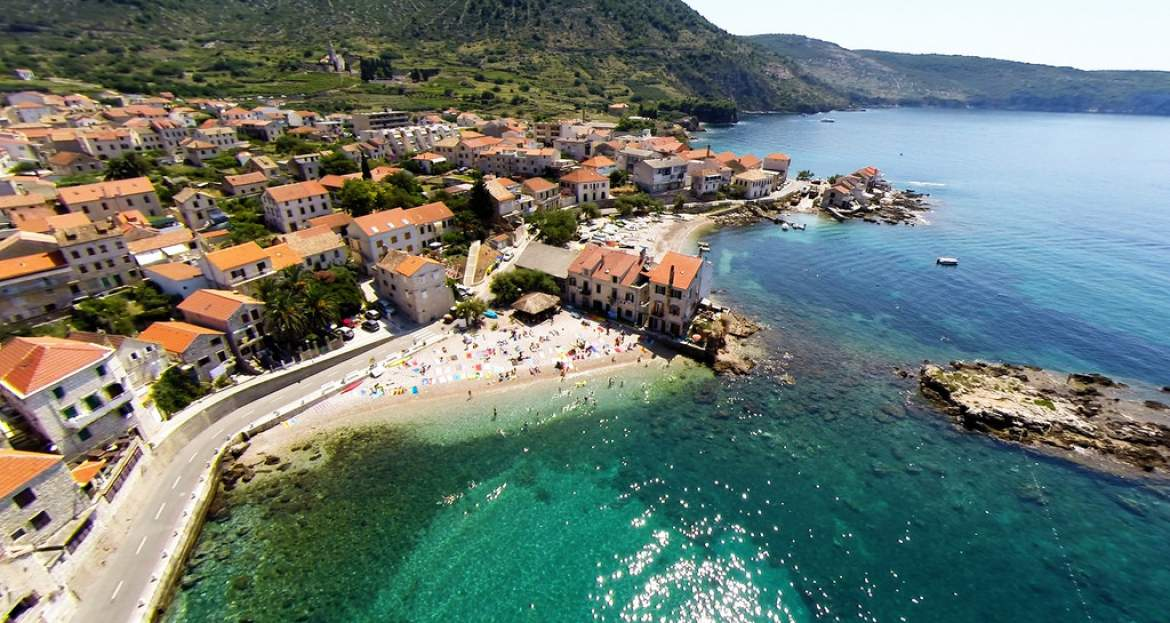 Komiza beach and old town
