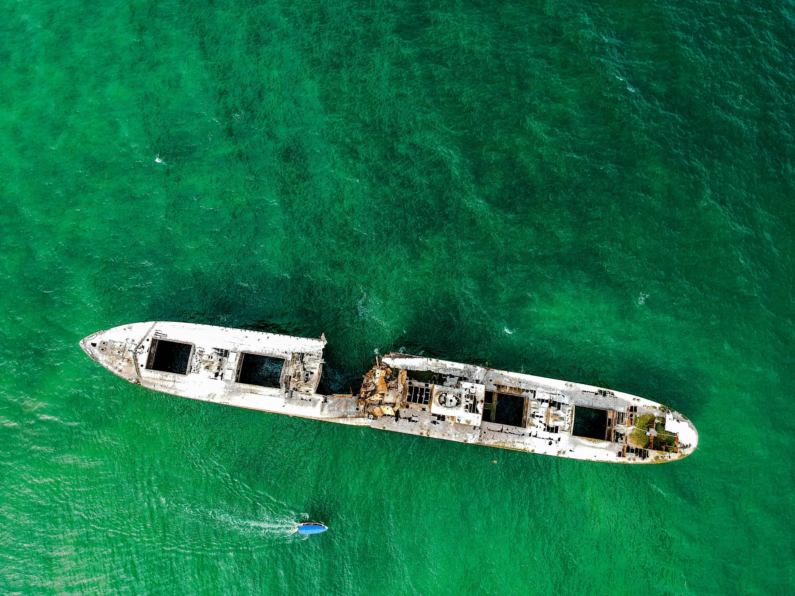 top-view-photo-of-abandoned-white-ship-on-sea-3520249